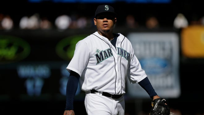 Seattle Mariners starting pitcher Felix Hernandez walks on the field during a baseball game against the Texas Rangers, Thursday, Sept. 10, 2015, in Seattle.