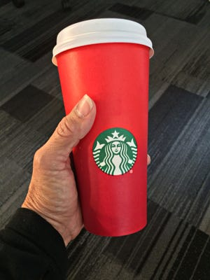 A consumer holding the 2015 Starbucks holiday cup in Washington, D.C.