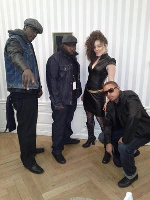 "The backing vocalists of D'Angelo's Vanguard from left to right are Ahrel Lumzy, Jermaine Holmes, Kendra Foster, and Charles ""Redd"" Middleton. The men are cousins, all of whom hail from New Brunswick. Foster also is know for her with the Plainfield-originated George Clinton & the P-Funk Allstars."