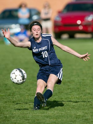 Bay Port's Katie Anderson (10) sends off a pass while playing against the Wildcats at Oshkosh West High School on Friday, May 6, 2016.