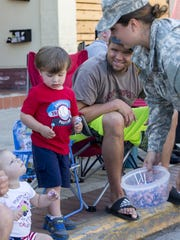 Children stock up on sweets while atending the Oshkosh Fourth of July parade.