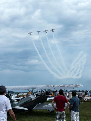 People watch the air show on the EAA grounds during AirVenture on Wednesday, July 27, 2016.