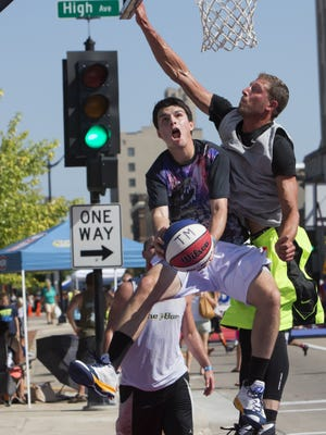 Ryan Sullivan on the Wisconsin Blaze team attempts a shot over Kyle Krueger with the No Blood No Foul team  in the Top Men class of the Gus Macker basketball tournament last year. This year's tournament is Saturday and Sunday, Aug. 27 and 28.