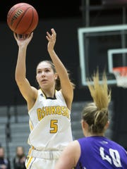 UW-Oshkosh's Chloe Pustina shoots during a February 2017 game.