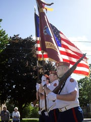 Marine Corps League veterans march in Monday's Memorial Day procession in Oshkosh.