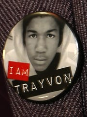 Sybrina Fulton wears a button with a photo of her son,