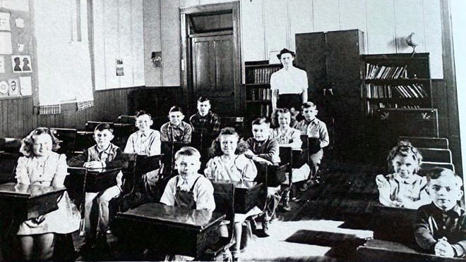 Members of the Fairland School in 1946. Lydia (Osborn) Lemme, teacher in the back. First row: Lyle Johnson and Elaine (Hubbard) Pharis. Second row: Leroy Deiss, Josie (Been) Worth Broughton, Loren Johnson, Donna (Bartmann) Hellman and Franklin Johnson. Third row: Soloewa (Bartmann) Albert, Allan Podbelsek, Paul Been, Franklin Podbelsek and Donald Semple.