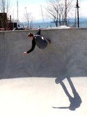 Andrew Bock, a freshman at UVM, rides a near-vertical