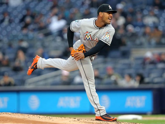Miami Marlins relief pitcher Jarlin Garcia (66) pitches against the New York Yankees during the first inning at Yankee Stadium.