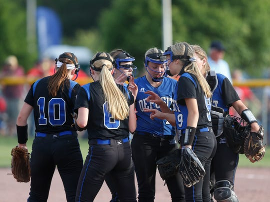 Deposit's softball team pump each other up at the start of an inning  during the Class D final against Fort Ann at the NYSPHSAA Softball Championships in Ganesvoort on June 9, 2018.