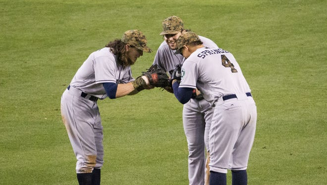 Houston Astros outfielders Colby Rasmus (left), Jake Marisnick (center) and George Springer take a bow after beating the Arizona Diamondbacks 8-3 at Chase Field in Phoenix May 30, 2016.