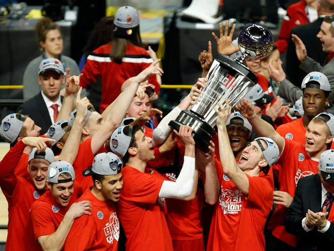 Wisconsin players celebrate with the trophy after winning
