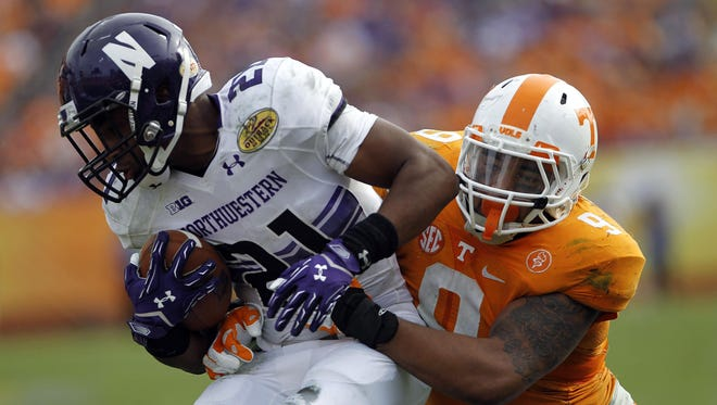 The Vols return five of their top six tacklers from last season, including defensive end Derek Barnett (9), shown tackling Northwestern running back Justin Jackson in the second half at the 2016 Outback Bowl.