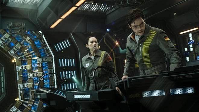 """Ziyi Zhang and Daniel Bruhl star in """"The Cloverfield Paradox."""""""