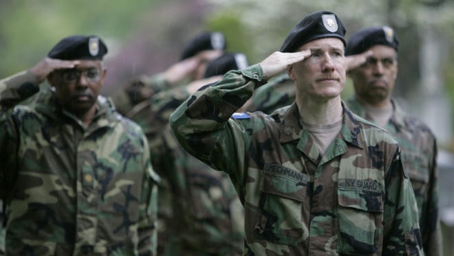 Members of the New York Guard salute during the 91st annual Aqueduct Defense Memorial Service at Sleepy Hollow Cemetery May 3, 2009.  ( Ricky Flores  / The Journal News)