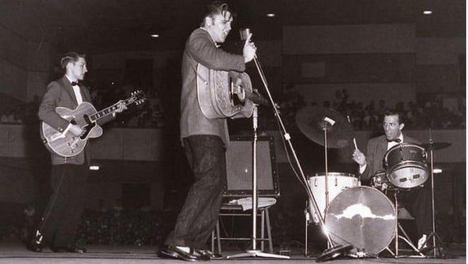 Elvis Presley performs at Augusta's Bell Auditorium in 1956.