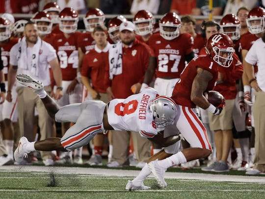 Indiana's Simmie Cobbs Jr. (1) is tackled by Ohio State