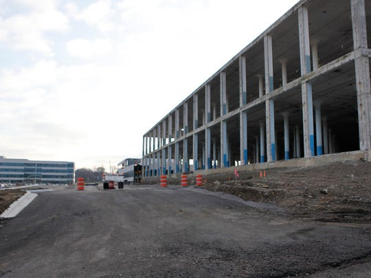 The building under construction on the right is a garage on Medpace's Madisonville campus. The garage, which now features brightly painted support columns, will be replaced by a hotel that will be part of a $100 million commercial development at the campus.