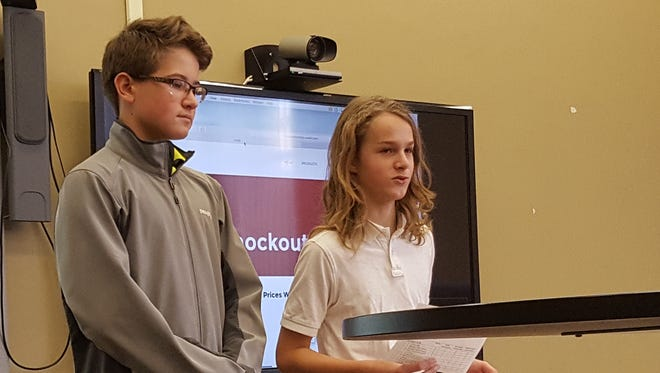 John Belton (left) and Gabe Clausing pitch their business Knock Out Hosting at D.C. Everest Junior High on Wednesday.