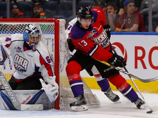 Gabriel Vilardi (13) of Team Cherry skates around the net against Team Orr during the third period of their Sherwin-Williams CHL/NHL Top Prospects Game on Jan. 30, 2017 in Quebec City, Quebec, Canada.