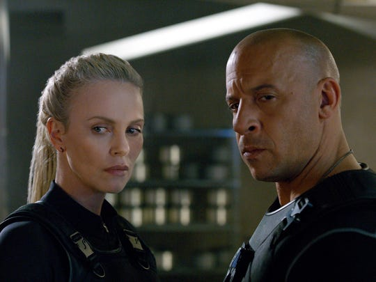 "Charlize Theron, left, and Vin Diesel in ""The Fate of the Furious."""