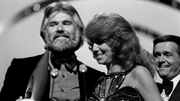 Kenny Rogers, left, and Dottie West accepts their Vocal