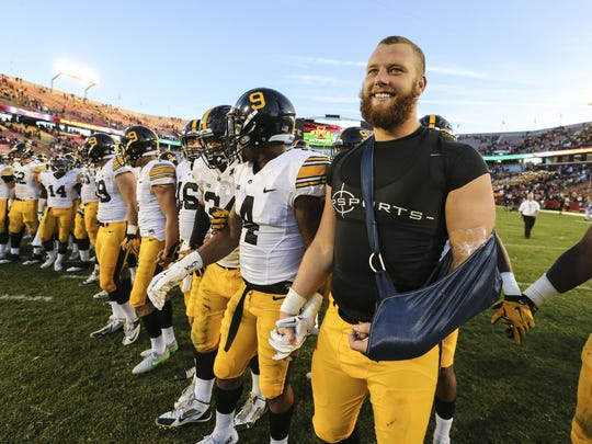 Iowa's Drew Ott, his dislocated left elbow in a sling,