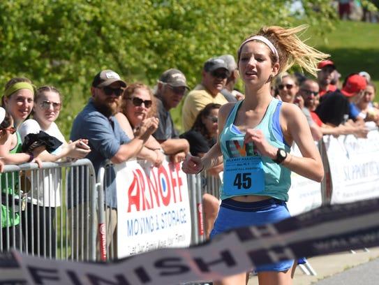 Rachel Darling crosses the finish line as the women's