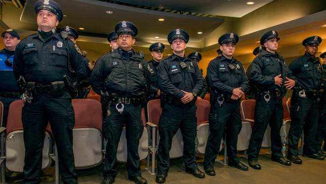 Patrolmen take roll call and get their assignments in Providence, R.I.