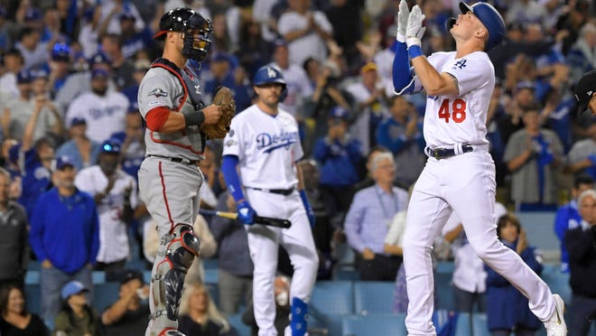 Los Angeles Dodgers' Gavin Lux celebrates his home run against the Washington Nationals during the eighth inning of Game 1 of baseball's National League Divisional Series on Thursday, Oct. 3, 2019, in Los Angeles. (AP Photo/Mark J. Terrill)
