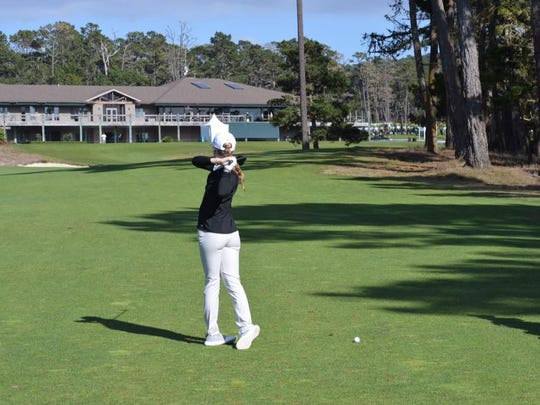 Catholic HIgh senior Madelyn Dimitroff hits an approach shot during a practice round for Friday's PGA Tour-Champions Tour First Tee Nature Valley Classic at Pebble Beach where she will be paired with Pensacola's Joe Durant in the  tournament.