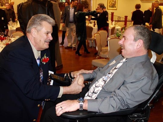 Joe Young (left) and Rich Myers share some time on Sunday at the Haddon Township Athletic Hall of Fame induction ceremony on Sunday night. Myers was an inductee as was Young's son Brett Young. Joe Young was an influence and role model for Myers during his time with the Haddon Township Athletic Association.