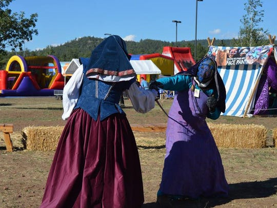 Women get in on the sword-fighting action at the Medieval