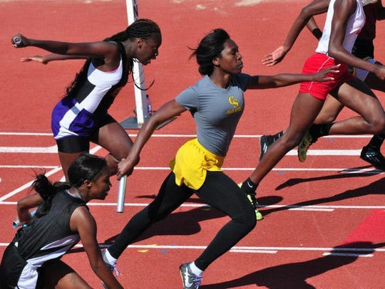 Chatéri Payne, in yellow shorts, during a Captain Shreve High School track meet.