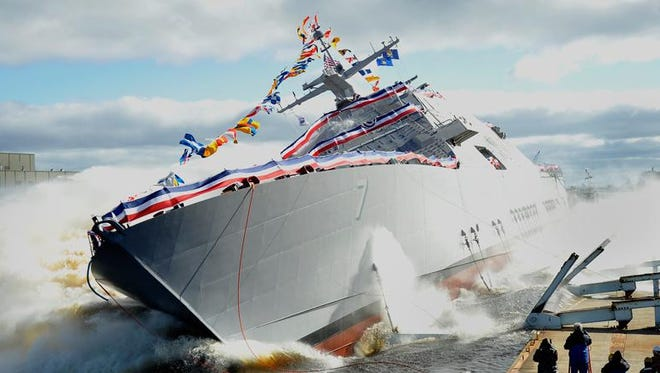 The future USS Detroit splashes into the Menominee River during Saturday's ceremony.