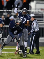 Dallastown's Steven Dunczyk (6) and Brice Register (52) celebrate after sacking Central York quarterback Cade Pribula in the first half of a YAIAA football game Friday, Oct. 28, 2016, at Dallastown.