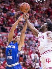 Tyreke Key of Indiana State University works against