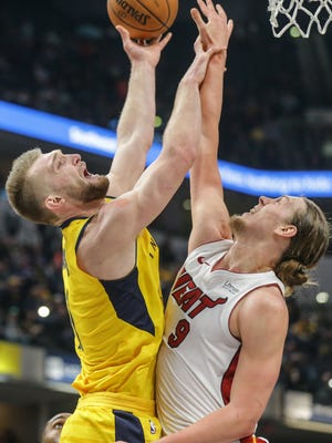 Indiana Pacers center Domantas Sabonis (11) and Miami Heat center Kelly Olynyk (9) reach for a rebound during a game at Bankers Fieldhouse on Wednesday, Jan. 10, 2018.
