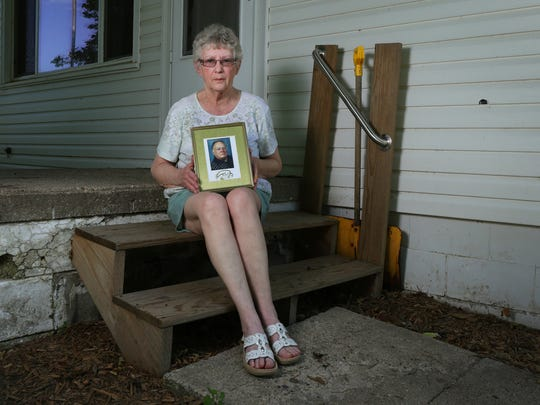 Myrna Hunt, a widow from Runnells, sits on the steps of the home she was renting with her husband, Burt, when he collapsed and died in 2013. Despite two calls to 911, responders didn't arrive for 46 minutes.