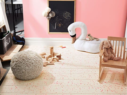 Paint splatter is a great idea for a child's room because it's so lively and fun.