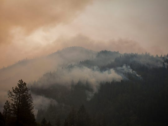 The sun peeks through the smoke and burned out trees near Whiskeytown Lake along Highway 299 in the Whiskeytown Shasta-Trinity National Recreation Area Monday July 31, 2018 near Redding, CA. The area burned as a part of the Carr Fire, which has reached only 20 percent containment as of Monday morning. Crews head down Highway 299 near the Trinity County line where the fire is still unpredictable.