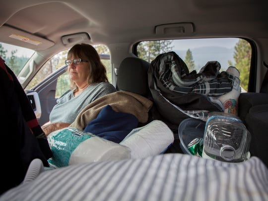 Jeanie Gray, of Lewiston, sits in the pick-up truck, which held all her family could carry as they evacuated from their home in Trinity County late Sunday evening, July 29, 2018 and drove to a shelter in Weaverville because of the Carr Fire.