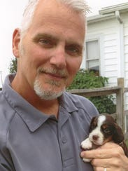 Bill Bryant with Riley as a puppy in early 2013. Bill