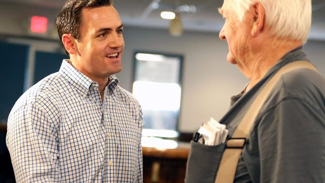 Mike Gallagher, Republican candidate for the 8th Congressional District, talks with Marine Corps veteran David Jacobson, of Suamico, Thursday, Sept. 8 at Stadium View Bar and Grille.