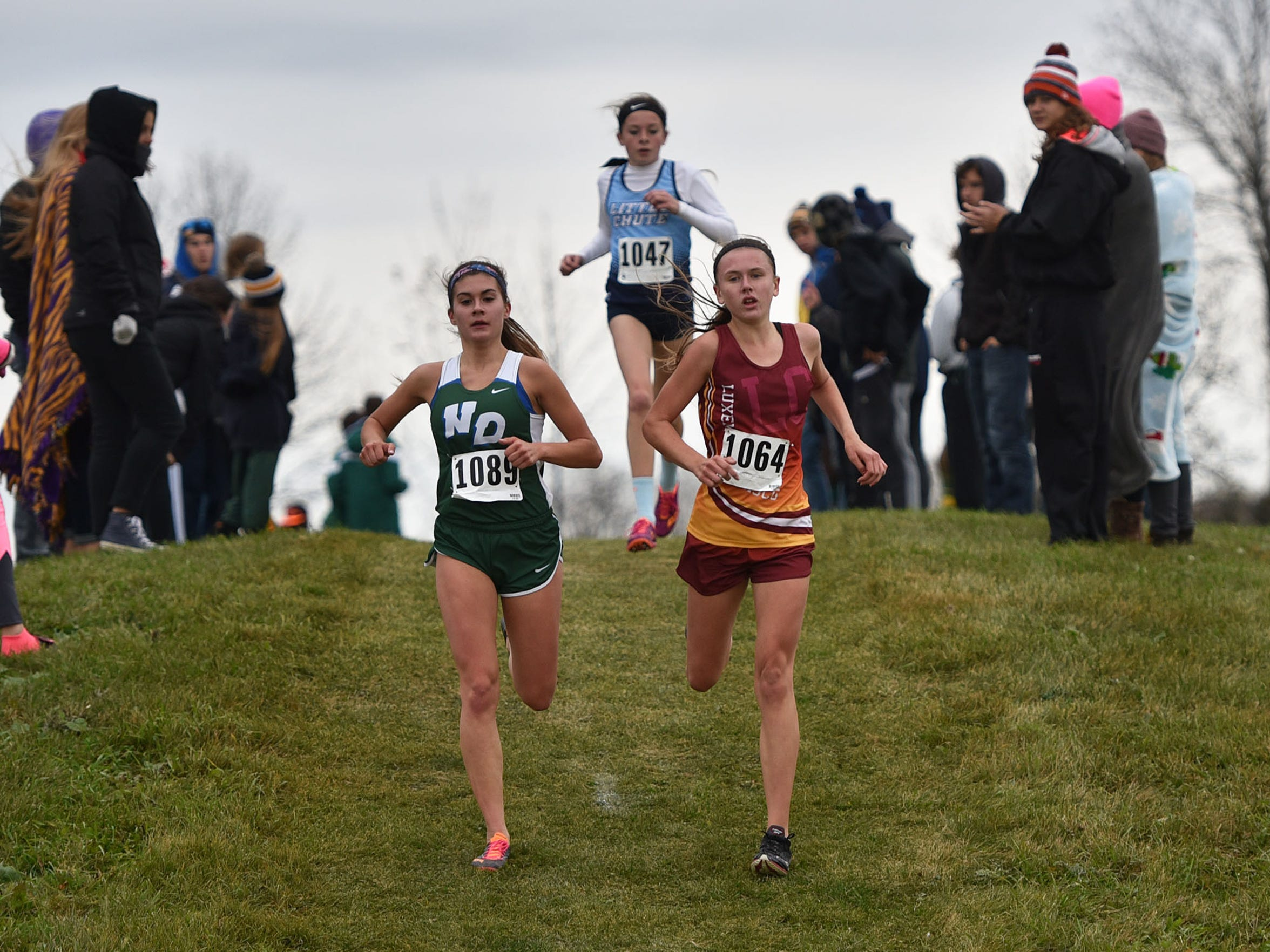 Luxemburg-Casco's Jacie Legois, right, races with Green Bay Notre Dame's Maria Ehlinger at the WIAA Division 2 Two Rivers sectional.