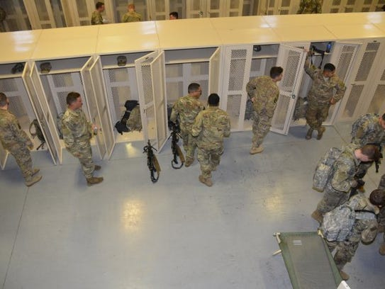 Soldiers from the 10th Mountain Division secure equipment