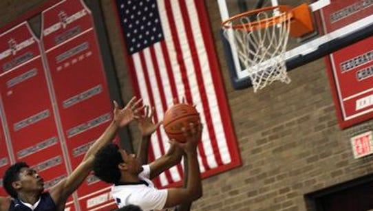 Kennedy junior Malachi de Sousa drives to the basket
