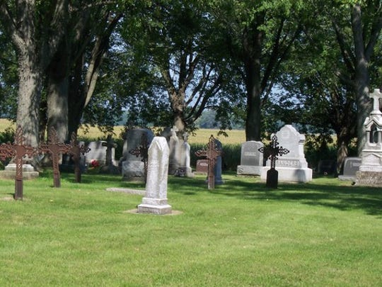Iron cemetery crosses at St. George Catholic Cemetery, Town of Wilson.