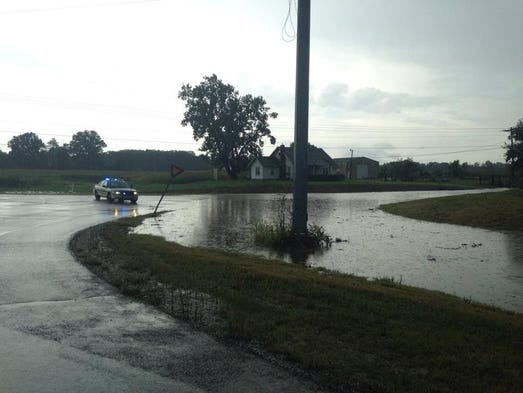 Rain waters covered yards, driveways and streets in communities throughout Jackson, and our readers and staff grabbed their phones and cameras to document the flooding. This photo shows flooding Monday on Ashport Road.