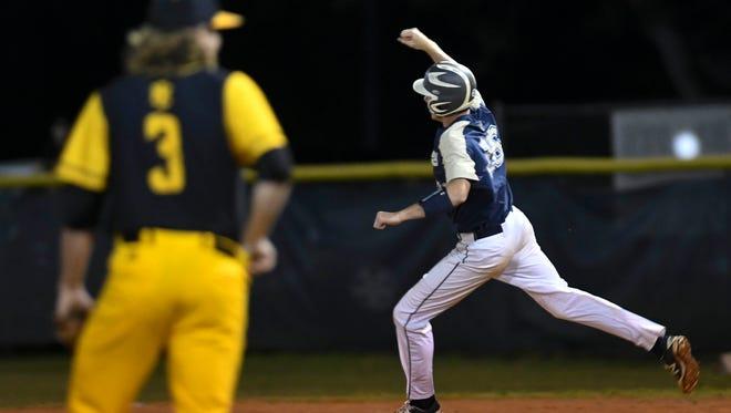 Eau Gallie's Carter Stewart celebrates his second inning home run during Thursday's district championship game against Merritt Island.